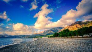 Beach Pebbles Coast Mountains Sea  - fietzfotos / Pixabay