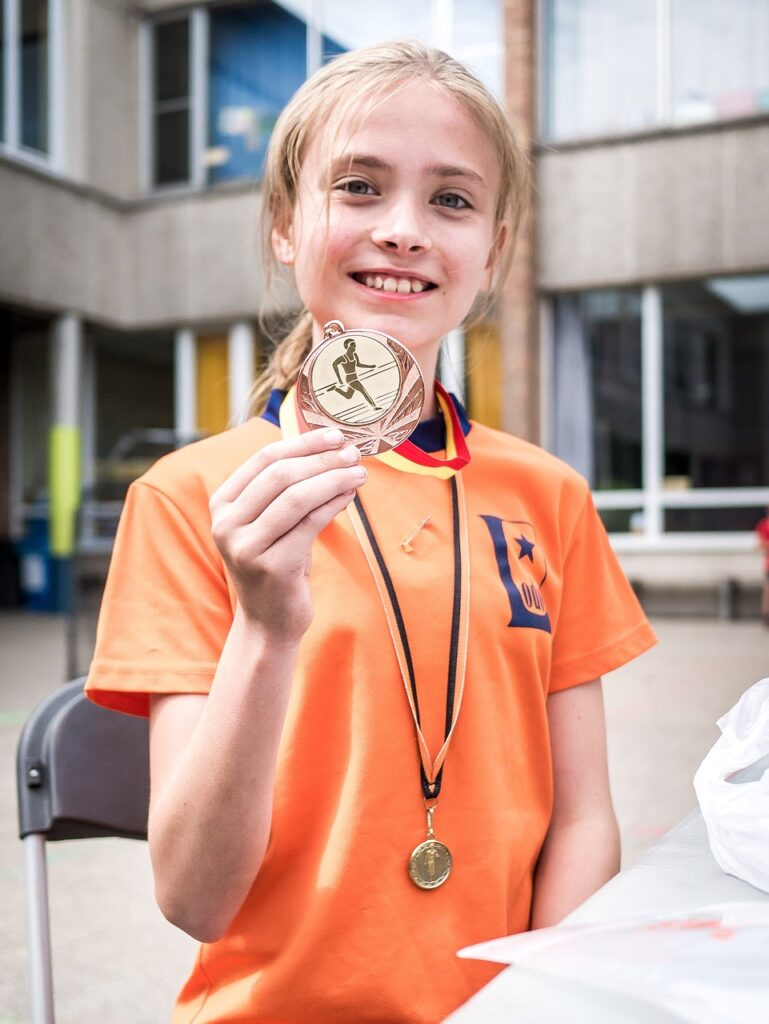 Girl Medal Happy Sport Winner  - superdirk / Pixabay