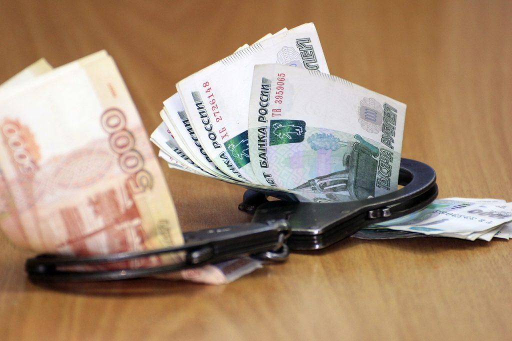 Handcuffs Money Corruption Economy  - sajinka2 / Pixabay