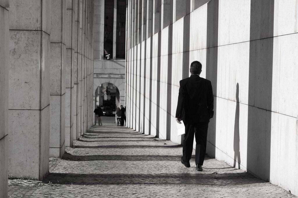 Man Sidewalk Monochrome Columns  - paulaguerreiro / Pixabay