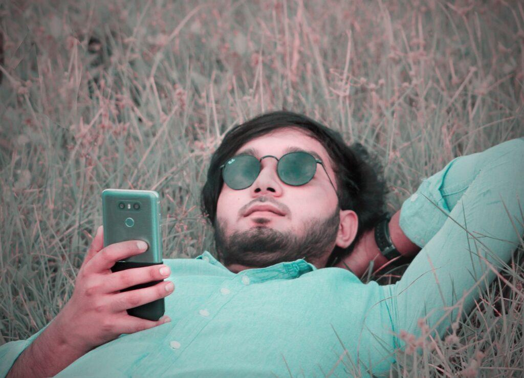 Man Smartphone Sunglasses Meadow  - aliakberplabon / Pixabay