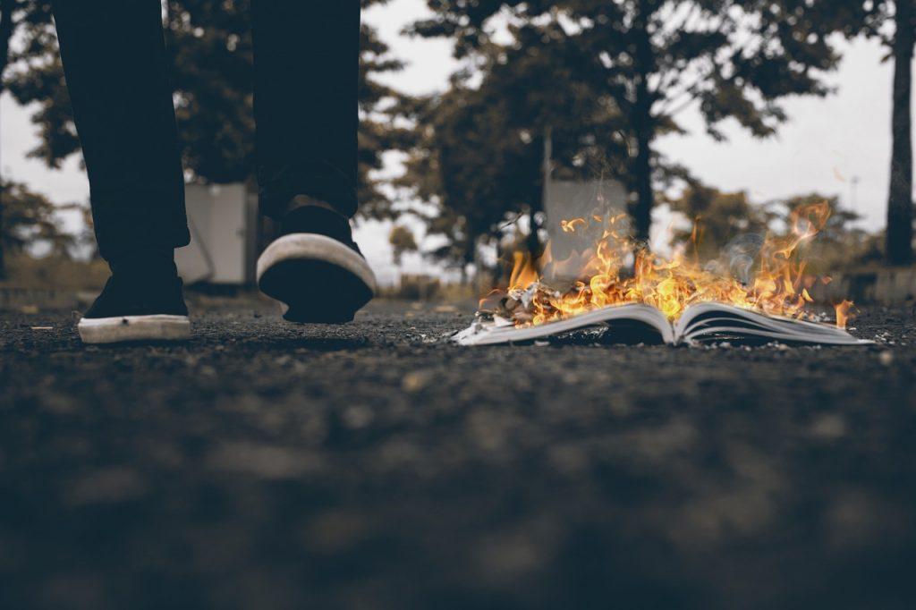 Man Walking Burning Book Burnt  - Om_Om_Om / Pixabay