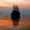 Ship Sea Sunset Sailing Ocean  - papazachariasa / Pixabay