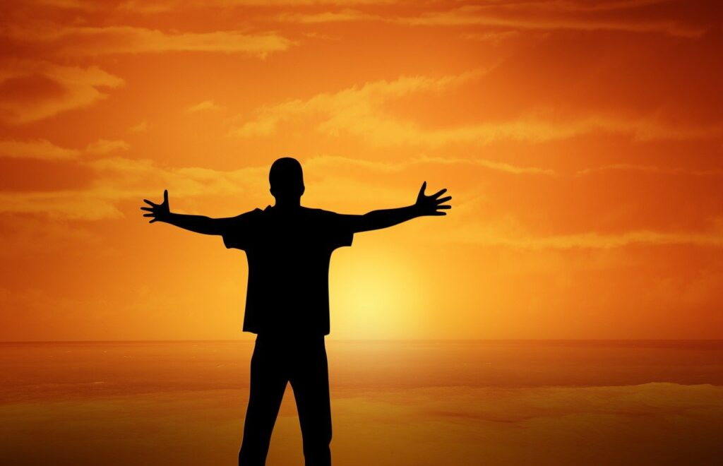 Sunset Boy Open Arms Gesture  - geralt / Pixabay