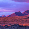 Sunset Desert Mountains Badlands  - fußspuren / Pixabay