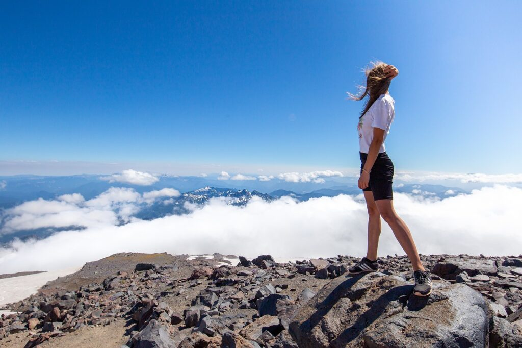 Woman Peak Summit Clouds  - sergiumarvel / Pixabay
